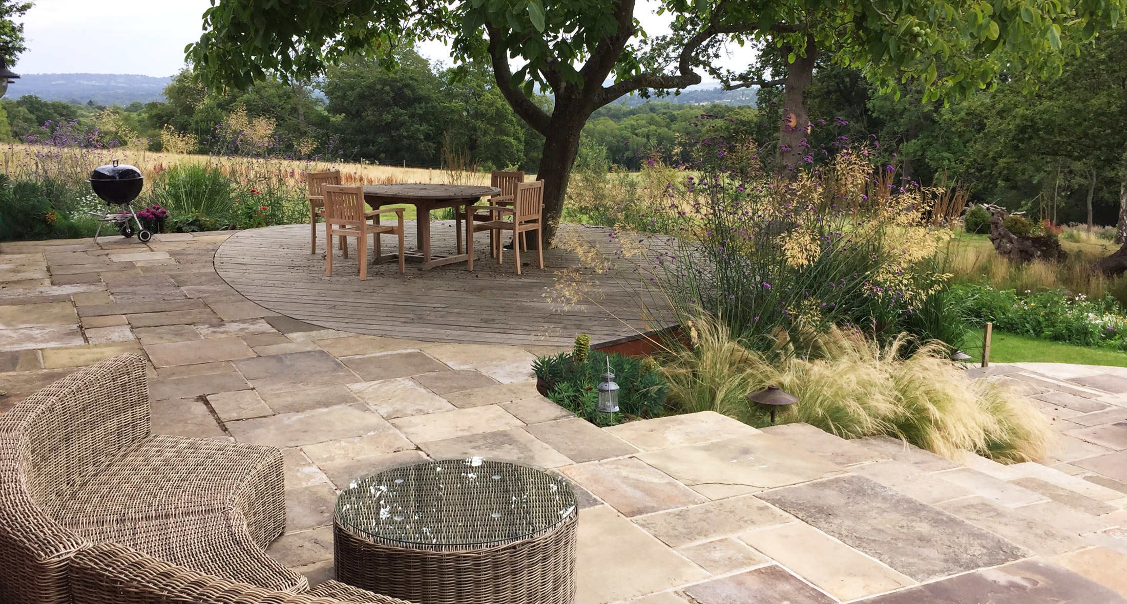 country garden patio and planting harmonious with the landscape
