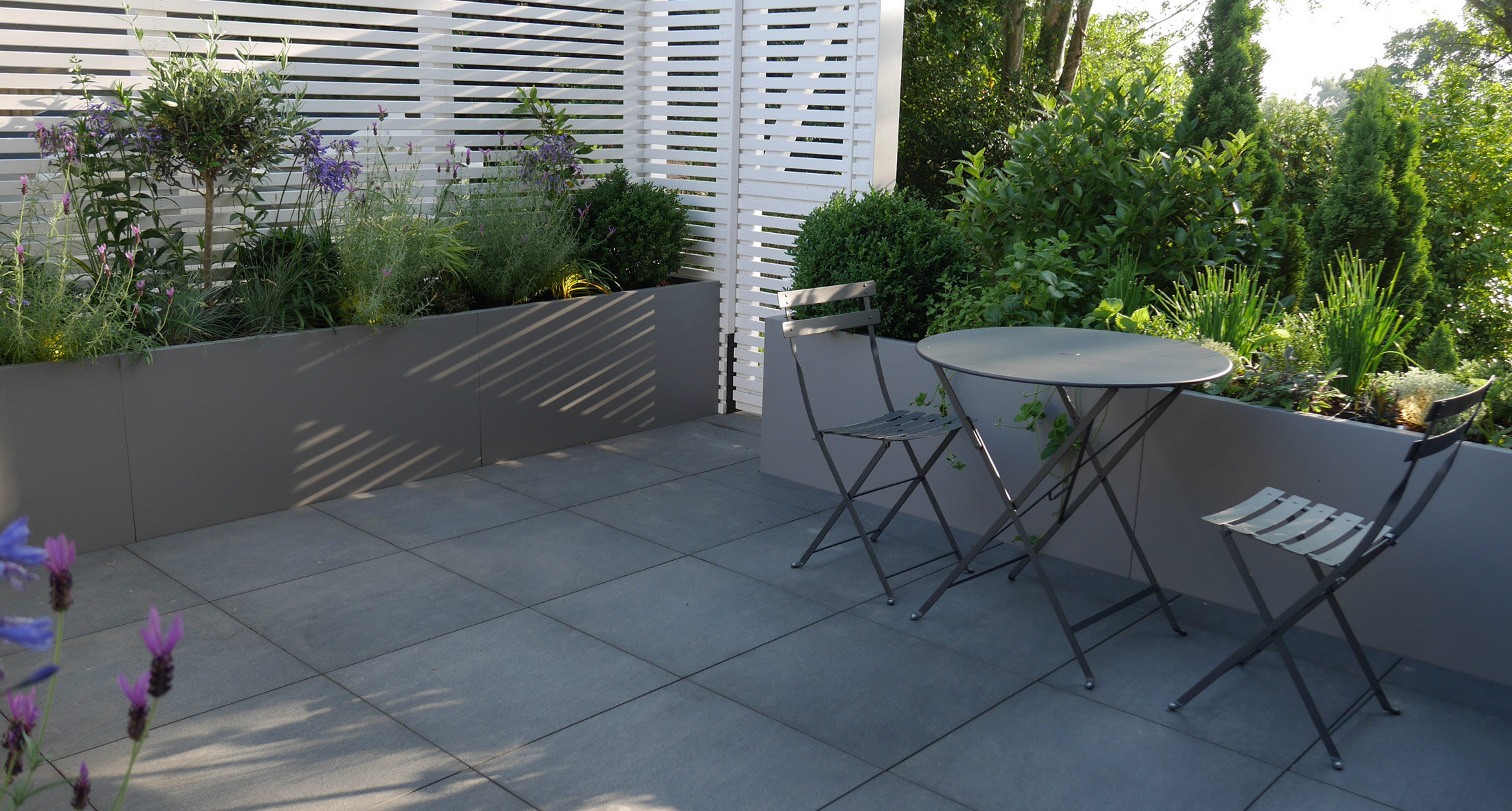 slate grey garden design roof top container planting screening and patio area in tunbridge wells