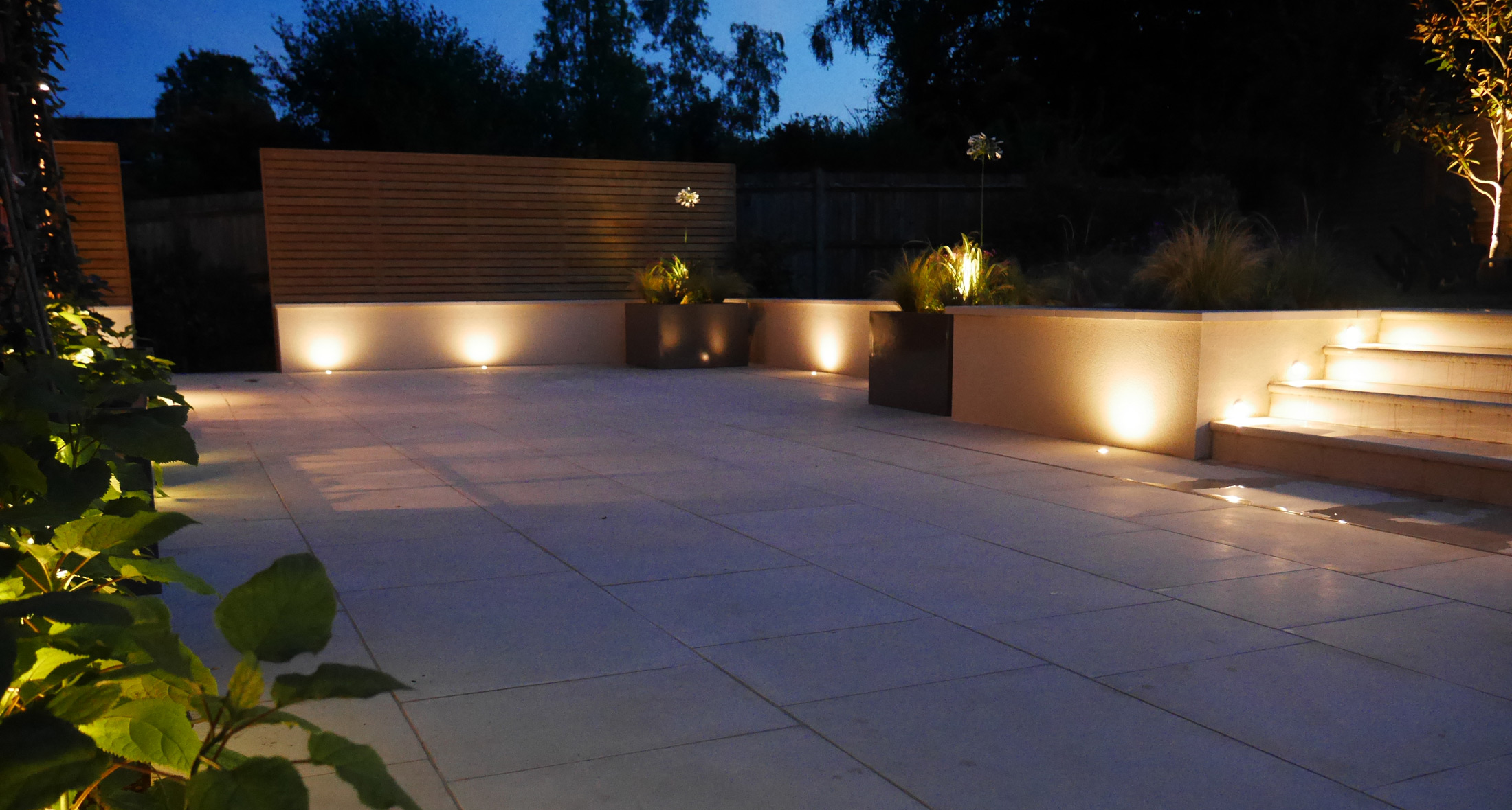 Slate Grey garden lighting downlighters on a wooden clad wall in a newly designed and landscaped garden in Tunbridge Wells, Kent
