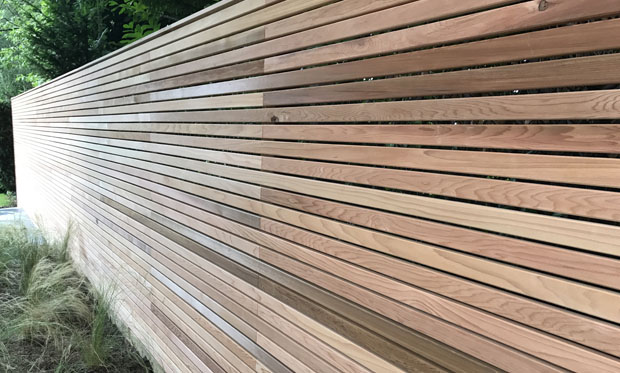 Slate Grey garden design slatted screen and grasses, East Sussex